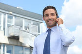 Businessman on mobile telephone — Stock Photo