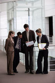 Business group gathered in the corridor — Stock Photo
