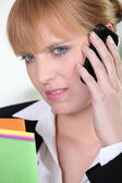 Unhappy woman talking on phone — Stock Photo