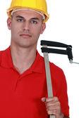 Ambachtsman houden een metalen meter — Stockfoto