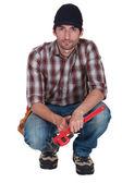 Crouching plumber — Stockfoto