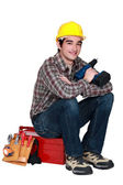 Young worker with a drill — Stock Photo