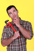 Craftsman holding a spanner — Stock Photo
