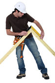 Man measuring truss — Stock Photo