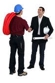 Tradesman and engineer meeting for the first time — Stock Photo
