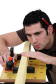 Woodworker working on a board — Stock Photo
