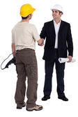 Architect and builder shaking hands — Stock Photo
