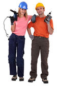 Couple stood with power drills — Stock Photo