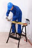 An artisan working on a copper tube — Stockfoto