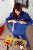 Repair girl preparing her tools — Stock Photo