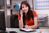 Woman booking customer appointment — Stock Photo