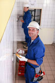 Two electricians working — Stock Photo