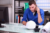 Construction foreman speaking on the phone — Stock Photo