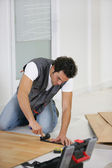 Man laying a wooden floor — Stock Photo