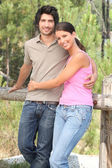 Happy couple stood in forrest — Stock Photo
