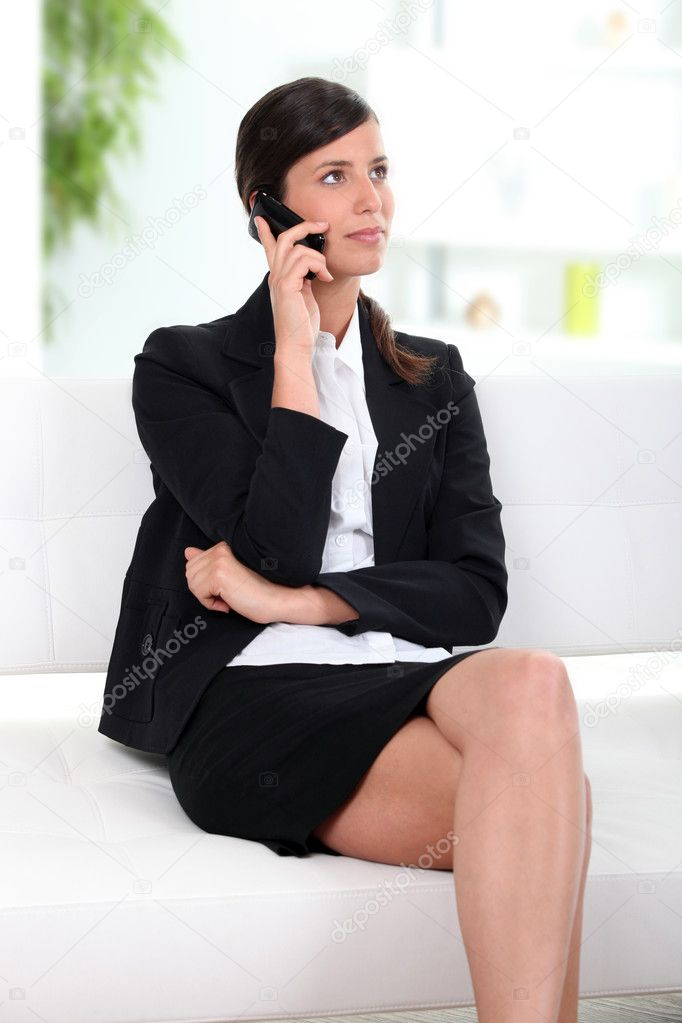 Business on cellphone in lobby — Stock Photo #8580243