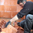 Mason smashing brick — Stock Photo
