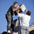 Roofers installing chimney — Stock Photo #8641915