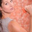 Young woman lifting dumbbell — Stock Photo #8642492