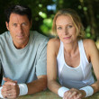 Couple resting after exercise — Stockfoto #8642584
