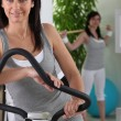 图库照片: Women doing exercise in fitness center