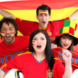 A group of show their support of the Spanish football team - Stock Photo