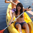 Stock Photo: Young couple canoeing