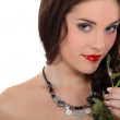 Woman holding a red rose — Stock Photo