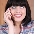 Woman with a broad grin talking on the phone — Stock Photo