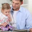 A father reading to her daughter. — Stock Photo #8648981