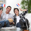 Two guys watching football on the couch — Stock Photo