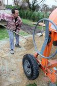 Labourer shovelling sand — Stock Photo