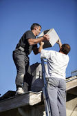 Roofers installing chimney — Stock Photo