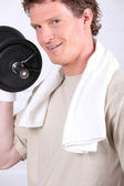 A man doing fitness with dumbbell — Stock Photo