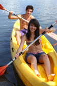 Young couple canoeing — Stock Photo