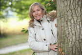 Woman out for an autumn stroll in the woods — Stock Photo
