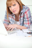 Red-haired lazy studying at home — Stock Photo