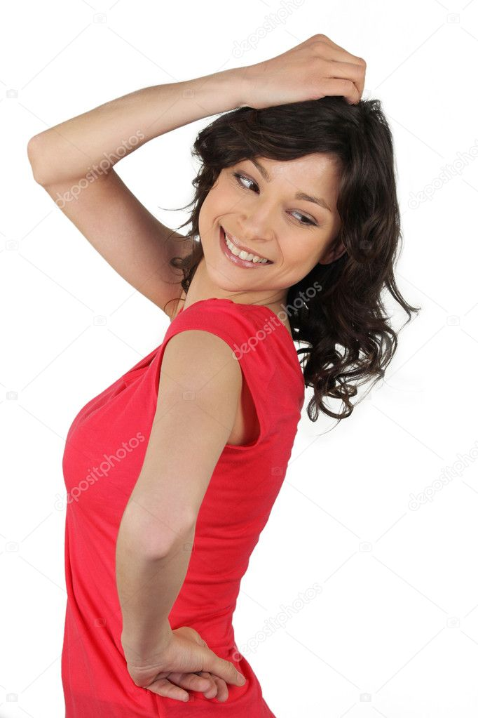 Brunette woman trying on clothes  Stock Photo #8648492