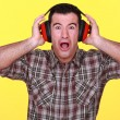 Stock Photo: Craftsmwearing headphones can't stand noise