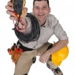 Electrician holding a measurement tool - Stock Photo