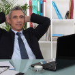 Foto Stock: Mature businessman in office