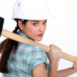 Woman carrying a mallet — Stock Photo