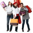 Women carrying bags and gifts — Stock Photo