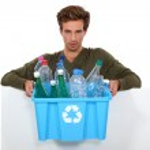Man holding box full of empty bottles — Stock Photo