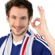 Portrait of young footballplayer making okay sign — Stock Photo