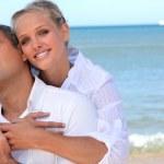 Loving couple on a beach — Stock Photo