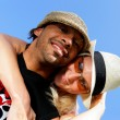 Stock Photo: Funky couple against a blue sky