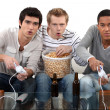 Boys night in with computer games, beer and popcorn — Stock Photo