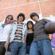 Group of teenagers in the street — Stock Photo #8654436