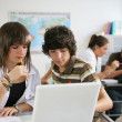 Stock Photo: Pupils studying in a classroom